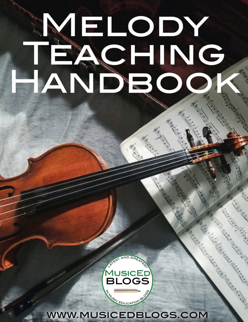 """This is a picture of a violin with the text """"Melody Teaching Handbook"""""""
